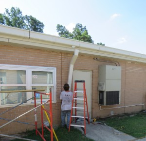 James Caldwell, a rising senior at Garrett Academy of Technology is an intern this summer with Team Craft Roofing - They are currently repairing the roof at A. C. Corcoran Elementary School.
