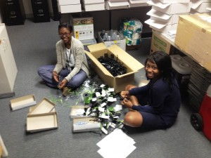 Dept of Teacher Effectiveness interns Tekkeris Simmons from R. B. Stall HS and Altoria Brown from Garrett Academy of Technology are packaging special gifts for the newest CCSD teachers.