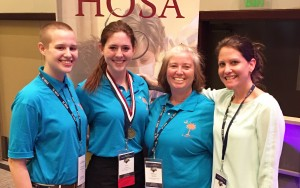 West Ashley High students Theo McLaughlin and Mary Johnson pose with HOSA Club sponsors Melissa Sparks and Julie Bamberg at the South Carolina HOSA State Leadership Conference.